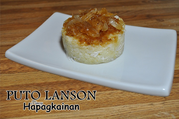 Puto Lanson Or Aripahol Are Steam Cassava Cake Made With Grated Cassava Sugar Young Coconut And Sold In Banana Leaves With Sweetened Coconut Sport Or